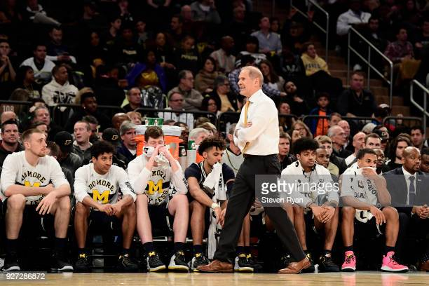 Head coach John Beilein of the Michigan Wolverines walks the sideline during the semifinals of the Big Ten Basketball Tournament against the Michigan...