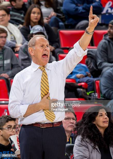Head coach John Beilein of the Michigan Wolverines watches the play from the sidelines against the Detroit Titans during game one of the Hitachi...
