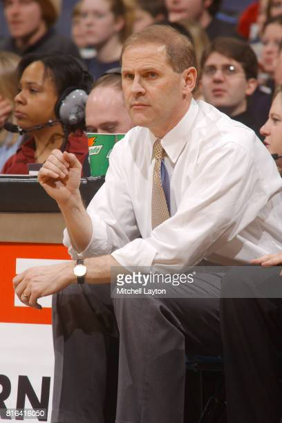 Head coach John Beilein of the West Virginia Mountaineers looks on during a college basketball game against the Georgetown Hoyas at MCI Center on...