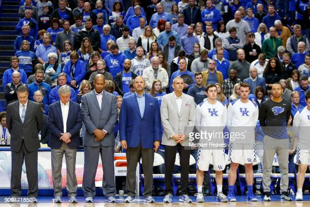 Head coach John Calipari and the Kentucky Wildcats pause for a moment of silence in honor of the victims of the deadly school shooting at Marshall...