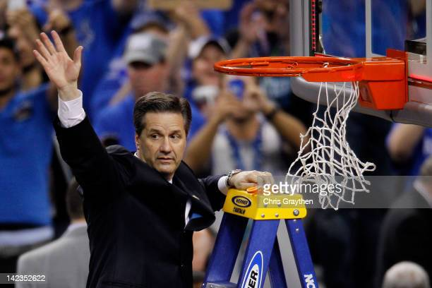 Head coach John Calipari celebrates as he prepares to cut down the net after the Wildcats defeat the Kansas Jayhawks 6759 in the National...