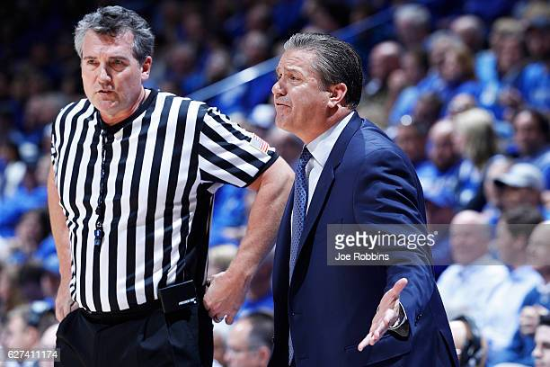 Head coach John Calipari of the Kentucky Wildcats argues with an official in the first half of the game against the UCLA Bruins at Rupp Arena on...