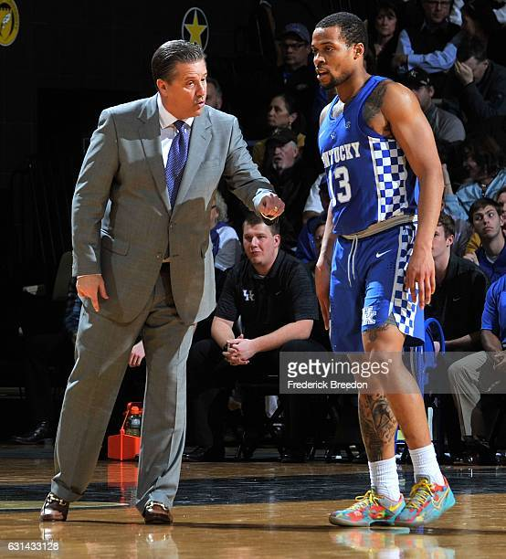 Head coach John Calipari of the Kentucky Wildcats coaches Isaiah Briscoe of the Kentucky Wildcats during the first half of a game against the...