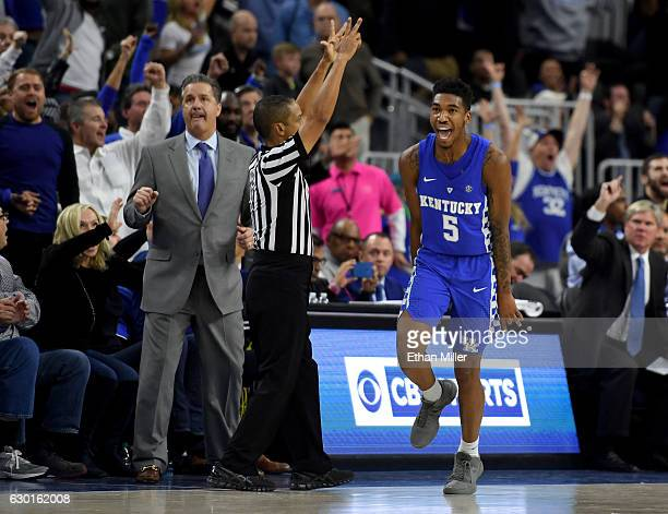 Head coach John Calipari of the Kentucky Wildcats looks on as Malik Monk celebrates after hitting a goahead 3pointer late in the team's 103100 win...