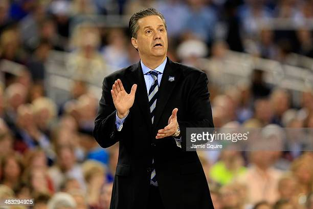 Head coach John Calipari of the Kentucky Wildcats motions to his players during the NCAA Men's Final Four Championship against the Connecticut...