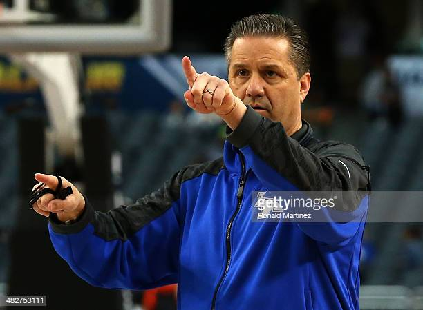 Head coach John Calipari of the Kentucky Wildcats points while the Wildcats practice ahead of the 2014 NCAA Men's Final Four at ATT Stadium on April...