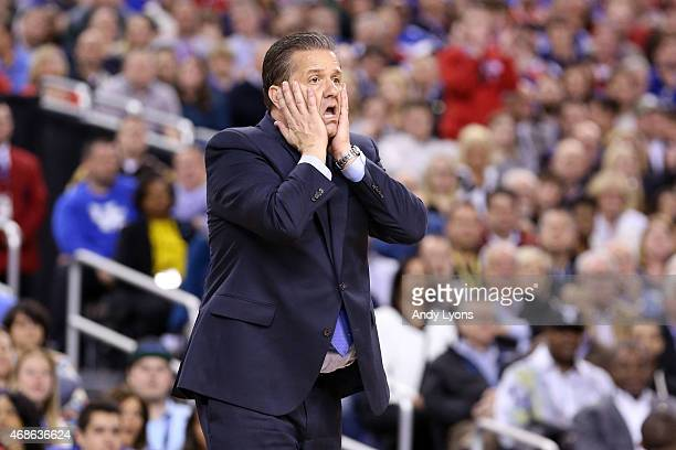 Head coach John Calipari of the Kentucky Wildcats reacts in the second half against the Wisconsin Badgers during the NCAA Men's Final Four Semifinal...
