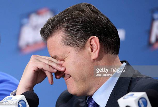 Head coach John Calipari of the Kentucky Wildcats reacts in the post game press conference after being defeated by the Wisconsin Badgers during the...