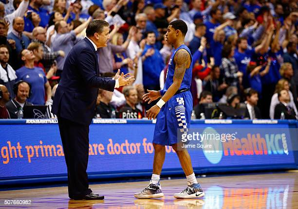 Head coach John Calipari of the Kentucky Wildcats talks with Tyler Ulis during the final minutes of overtime in the game against the Kansas Jayhawks...