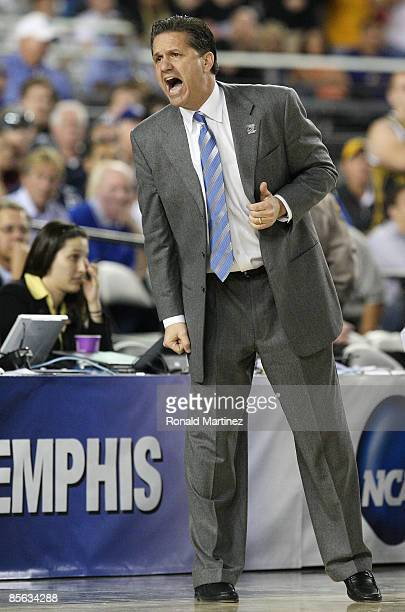 Head Coach John Calipari of the Memphis Tigers adjusts his team against the Missouri Tigers in the Sweet 16 of the NCAA Division I Men's Basketball...