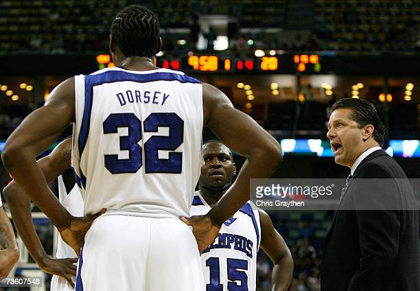 Head coach John Calipari of the Memphis Tigers talks to his team during a break in the first half of round one of the NCAA Men's Basketball...