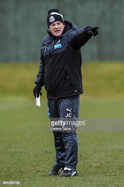 Head Coach John Carver points instructions whilst standing on the training pitch during a Newcastle United Training session at The Newcastle United...