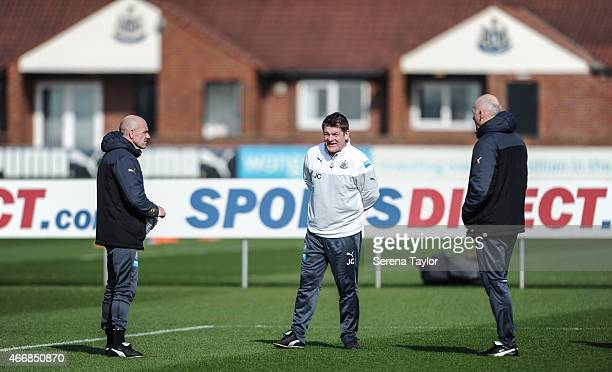 Head Coach John Carver stands on the training pitch with First Team Coach Steve Stone and Coach Dave Watson during a Newcastle United Training...