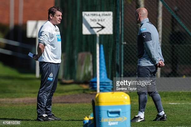 Head coach John Carver talks to coach Steve Stone during a Newcastle United Training session at The Newcastle United Training Centre on April 23 in...