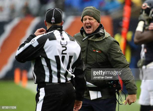 Head coach John Fox of the Chicago Bears exchanges words with line judge Bart Longson in the second quarter against the Green Bay Packers at Soldier...