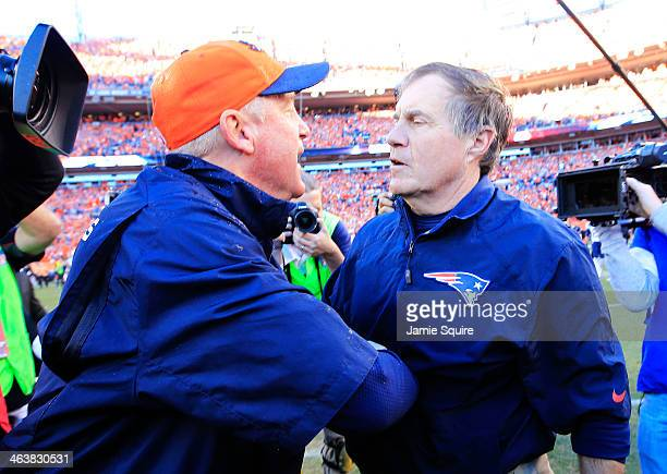 Head coach John Fox of the Denver Broncos and head coach Bill Belichick of the New England Patriots embrace after the Broncos defeated the Patriots...