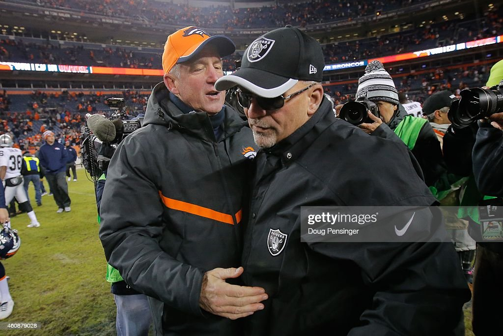 Head coach John Fox of the Denver Broncos and interim head coach Tony Sparano of the Oakland Raiders shake hands on the field after the Denver Broncos 47-14 win at Sports Authority Field at Mile High on December 28, 2014 in Denver, Colorado.