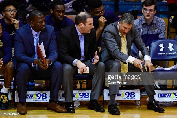 Head coach John Giannini of the La Salle Explorers reacts during the game with assistant coach Sean Neal as assistant coach Horace Owens looks on...