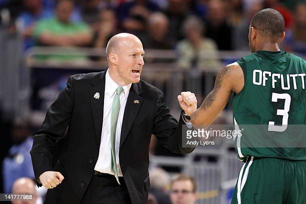 Head coach John Groce of the Ohio Bobcats reacts during a stop in play with Walter Offutt in the first half against the North Carolina Tar Heels...