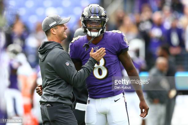 Head coach John Harbaugh interacts with Lamar Jackson of the Baltimore Ravens prior to playing against the Cincinnati Bengals at MT Bank Stadium on...