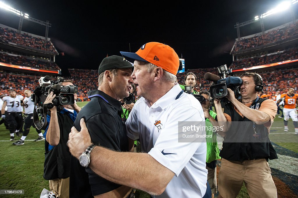 Head coach John Harbaugh of the Baltimore Ravens and Head coach John Fox of the Denver Broncos shake hands after the game at Sports Authority Field at Mile High on September 5, 2013 in Denver Colorado.