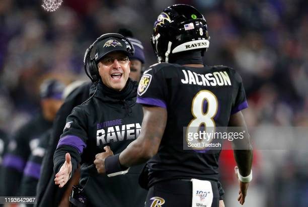 Head coach John Harbaugh of the Baltimore Ravens and quarterback Lamar Jackson celebrate a touchdown in the third quarter of the game against the New...