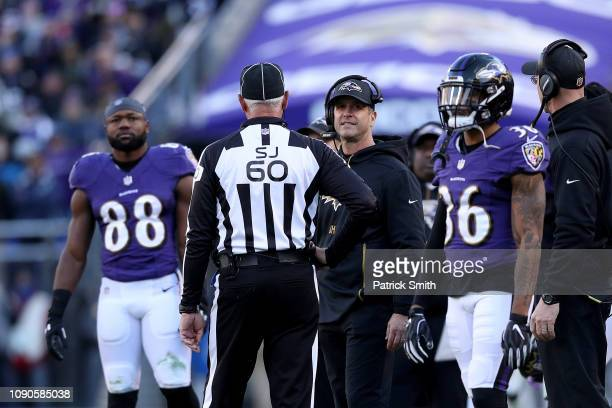 Head coach John Harbaugh of the Baltimore Ravens argues a call with Side Judge Gary Cavaletto against the Los Angeles Chargers during the fourth...