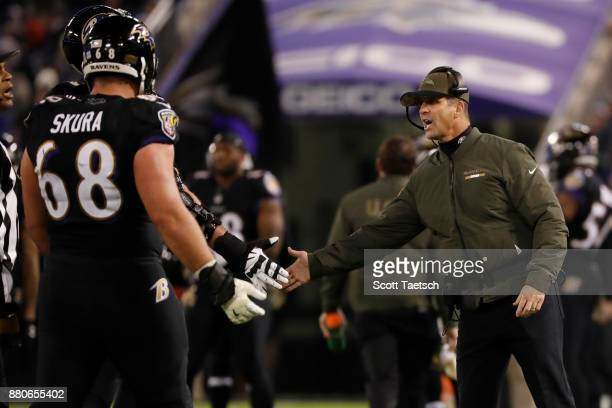 Head Coach John Harbaugh of the Baltimore Ravens celebrates after a field goal in the fourth quarter against the Houston Texans at MT Bank Stadium on...