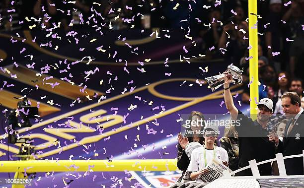 Head coach John Harbaugh of the Baltimore Ravens celebrates with the Vince Lombardi trophy next to his wife Ingrid and his daughter Alison after the...