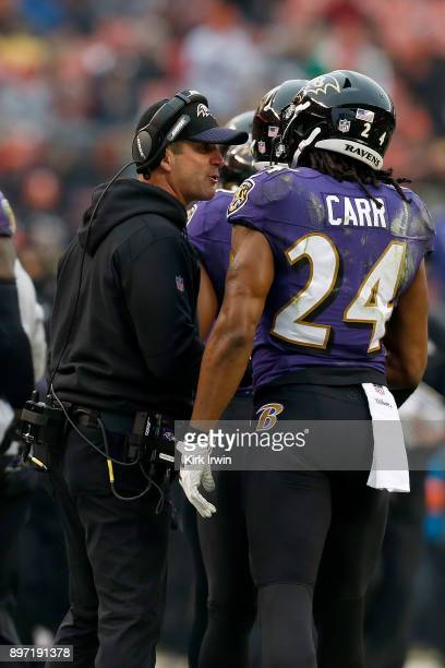 Head coach John Harbaugh of the Baltimore Ravens congratulates Brandon Carr of the Baltimore Ravens after making an interception during the game...