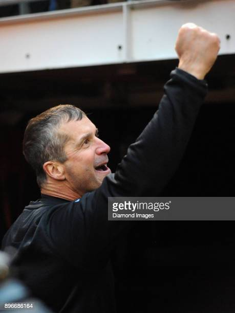 Head coach John Harbaugh of the Baltimore Ravens gestures toward fans as he walks off the field after a game on December 17 2017 against the...