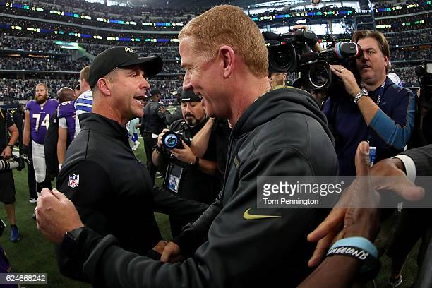 Head coach John Harbaugh of the Baltimore Ravens greets head coach Jason Garrett of the Dallas Cowboys at midfield after the Dallas Cowboys beat the...