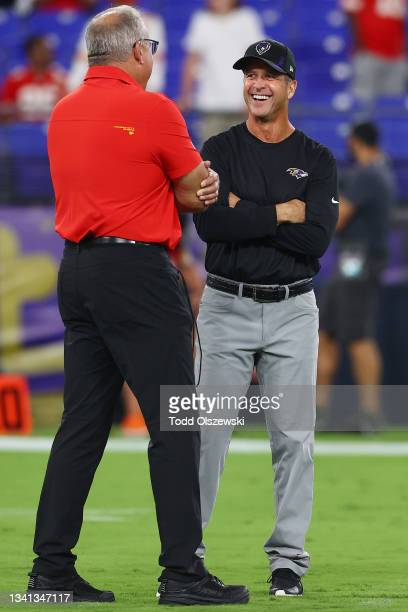 Head coach John Harbaugh of the Baltimore Ravens laughs on the field prior to the game against the Kansas City Chiefs at M&T Bank Stadium on...