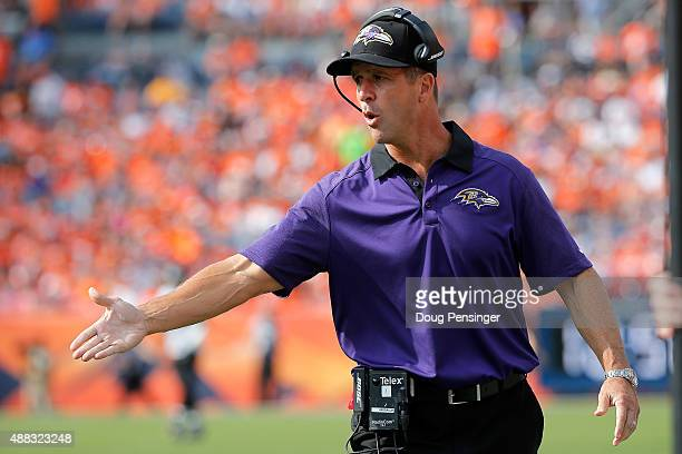 Head coach John Harbaugh of the Baltimore Ravens leads his team against the Denver Broncos at Sports Authority Field at Mile High on September 13...