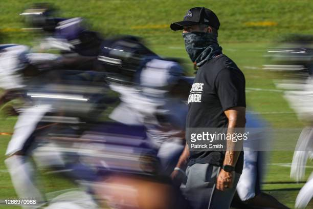 Head coach John Harbaugh of the Baltimore Ravens looks on during the Baltimore Ravens Training Camp at Under Armour Performance Center Baltimore...