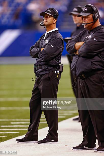 Head coach John Harbaugh of the Baltimore Ravens looks up at the scoreboard during the game against the Indianapolis Colts at Lucas Oil Stadium on...