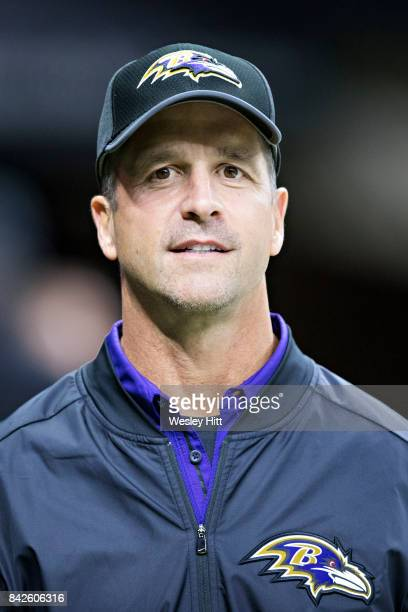 Head Coach John Harbaugh of the Baltimore Ravens on the field before a preseason game against the New Orleans Saints at MercedesBenz Superdome on...