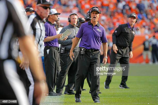 Head coach John Harbaugh of the Baltimore Ravens reacts in the fourth quarter of a game against the Denver Broncos at Sports Authority Field at Mile...