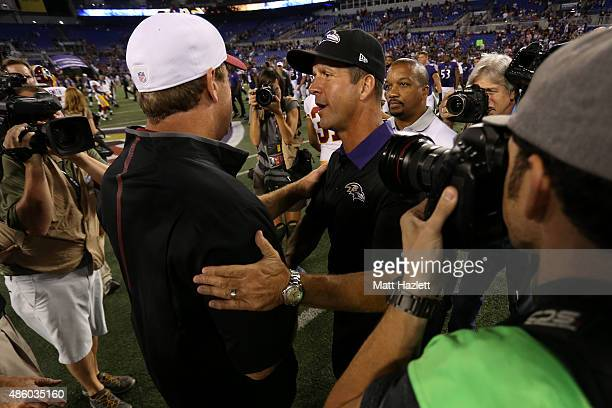 Head coach John Harbaugh of the Baltimore Ravens shakes hands with head coach Jay Gruden of the Washington Redskins after a preseason game at MT Bank...