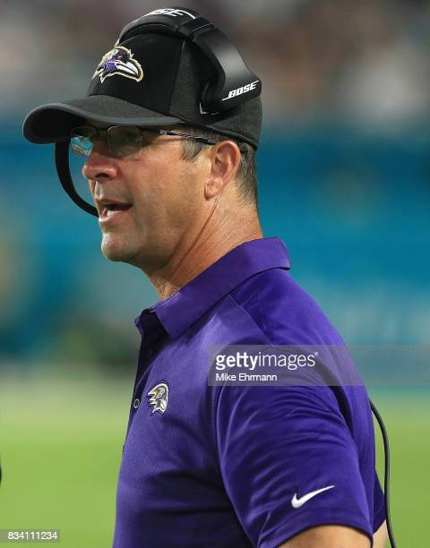 Head coach John Harbaugh of the Baltimore Ravens talks with officials during a preseason game against the Miami Dolphins at Hard Rock Stadium on...