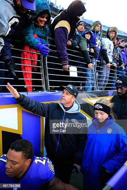 Head coach John Harbaugh of the Baltimore Ravens walks off the field with his daughter Alison following the Ravens 193 win over the New York Jets at...