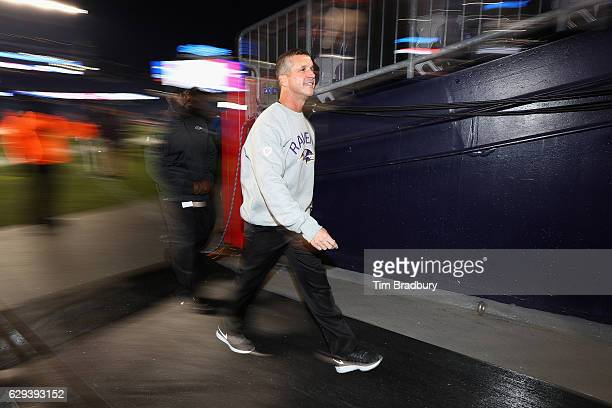 Head coach John Harbaugh of the Baltimore Ravens walks off the field before the game against the New England Patriots at Gillette Stadium on December...