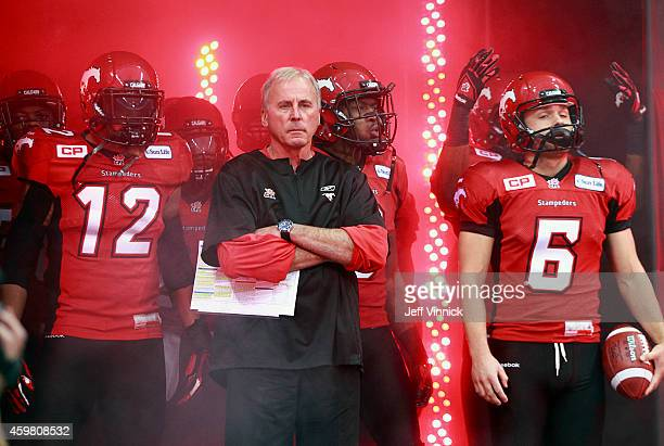 Head coach John Hufnagel of the Calgary Stampeders stands with players during the 102nd Grey Cup Championship Game at BC Place against the Hamilton...