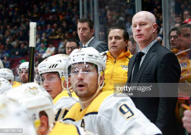 Head coach John Hynes of the Nashville Predators looks on from the bench during their NHL game against the Vancouver Canucks at Rogers Arena February...