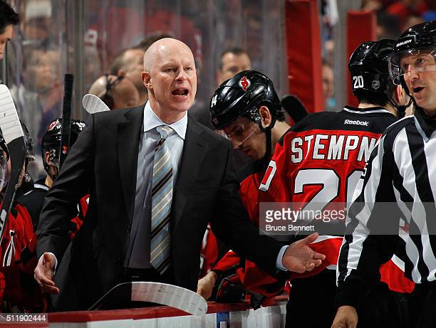 Head coach John Hynes of the New Jersey Devils argues a second period embellishment call against Joseph Blandisi during the game against the New York...