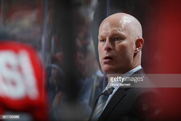 Head coach John Hynes of the New Jersey Devils handles bench duties against the Detroit Red Wings at the Prudential Center on December 11 2015 in...
