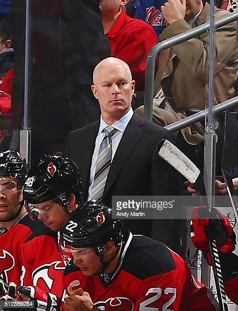 Head coach John Hynes of the New Jersey Devils looks on against the New York Rangers during the game at the Prudential Center on February 23 2016 in...