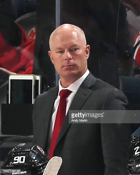 Head Coach John Hynes of the New Jersey Devils looks on during the game against the San Jose Sharks at Prudential Center on October 14 2018 in Newark...