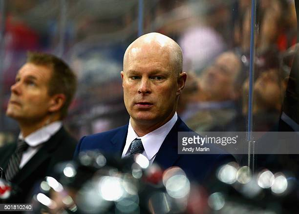 Head Coach John Hynes of the New Jersey Devils looks on during the game against the Florida Panthers at the Prudential Center on December 17 2015 in...