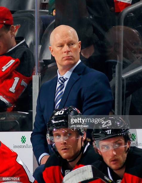 Head Coach John Hynes of the New Jersey Devils looks on during the game against the Dallas Stars on March 26 2017 at Prudential Center in Newark New...